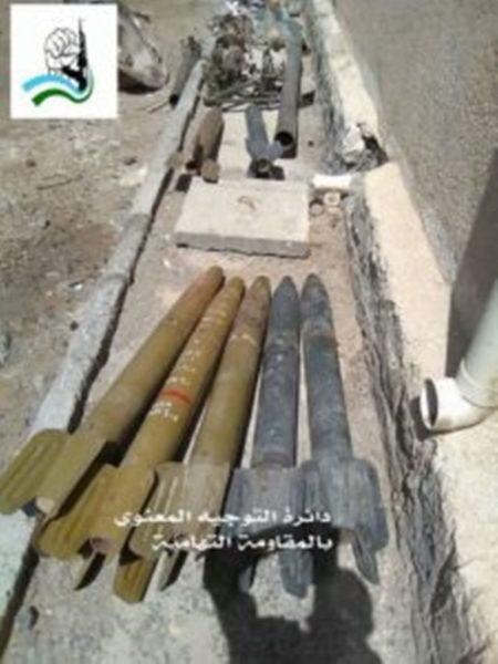 قوات الجيش الوطني تعثر على مخزن أسلحة وصواريخ أثناء عمليات تمشيط في مزارع بمديرية الخوخة
