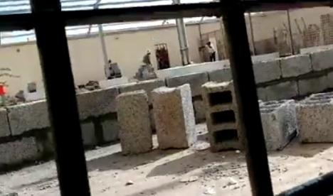 militias of security belt storm Bir Ahmed prison and assault detainees